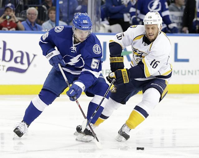 Tampa Bay Lightning right wing Nikita Kucherov (56), of Russia, battles with Nashville Predators left wing Richard Clune (16) for the puck during the second period of an NHL hockey game, Thursday, Dec. 19, 2013, in Tampa, Fla. (AP Photo/Chris O'Meara)