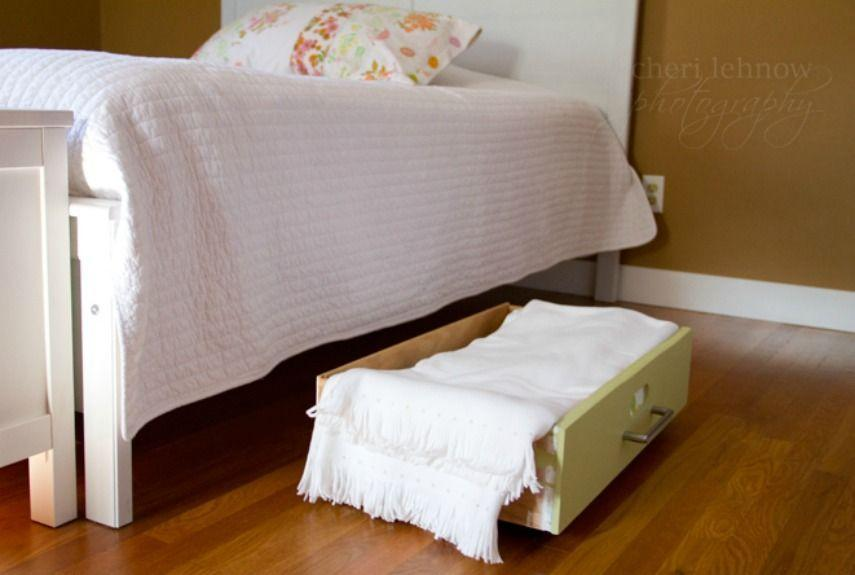 """<p>Before you drag an old piece of furniture out to the curb, consider repurposing the drawers as under-the-bed bins (add wheels to make access even easier). Bonus: They blend better with the room design than plastic boxes.</p><p><a href=""""http://tinkerwiththis.blogspot.com/2011/11/repurposed-drawer.html"""" rel=""""nofollow noopener"""" target=""""_blank"""" data-ylk=""""slk:See more at Tinker With This »"""" class=""""link rapid-noclick-resp""""><em>See more at Tinker With This »</em></a></p>"""