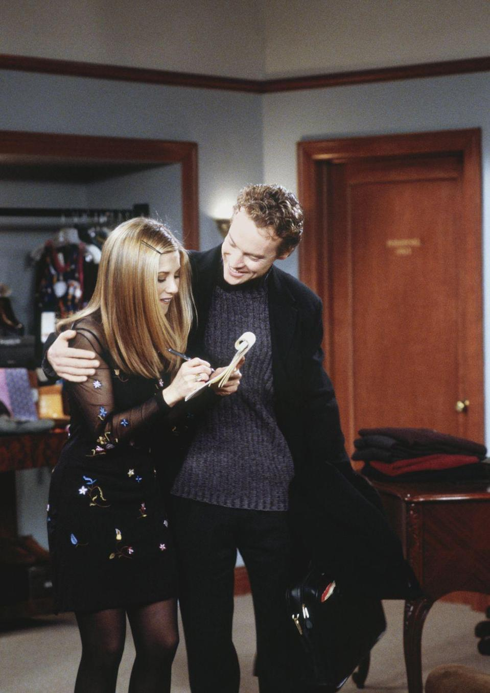 """<p>Tate Donovan dated Jennifer Aniston in real life throughout the first few seasons of the hit show, but when the actor appeared in season 4 as a reoccurring guest star (and Rachel Green's crush) the couple had already called off their engagement and parted ways. """"It was horrible...I remember just getting back to my dressing room and just weeping,"""" Tate told <a href=""""https://www.youtube.com/watch?v=gpFKoZ4fasg"""" rel=""""nofollow noopener"""" target=""""_blank"""" data-ylk=""""slk:HuffPost Live"""" class=""""link rapid-noclick-resp"""">HuffPost Live</a>.</p>"""