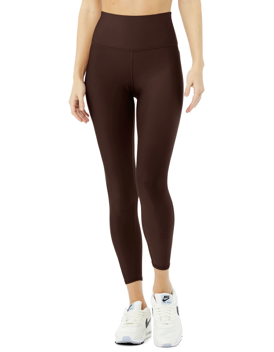 """Scoop up Alo's signature Airlift style if you want a high-rise legging that feels like second skin. The fabric feels smooth to the touch, and Harris says its a great option for sweaty workouts like running or spin because of how light and sweat-wicking the material is. The 7/8 crop is also ideal for petites who don't want a full-length legging that'll bunch up at the ankles. $114, Alo Yoga. <a href=""""https://www.aloyoga.com/products/w5766r-7-8-high-waist-airlift-legging-cherry-cola"""" rel=""""nofollow noopener"""" target=""""_blank"""" data-ylk=""""slk:Get it now!"""" class=""""link rapid-noclick-resp"""">Get it now!</a>"""