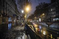 An empty street as the 6 p.m curfew starts in Paris, Saturday Jan.16, 2021. The prime minister announced Thursday an extension of the 6 p.m.-to-6 a.m. curfew to cover the whole country, including zones, like Paris, where it previously hadn't started until 8 p.m. Shopping and all outdoor leisure activities stop at curfew, only short pet walks allowed. Working and commuting allowed with note from employer. Food deliveries but not takeout allowed. Fines for curfew-breakers. (AP Photo/Lewis Joly)