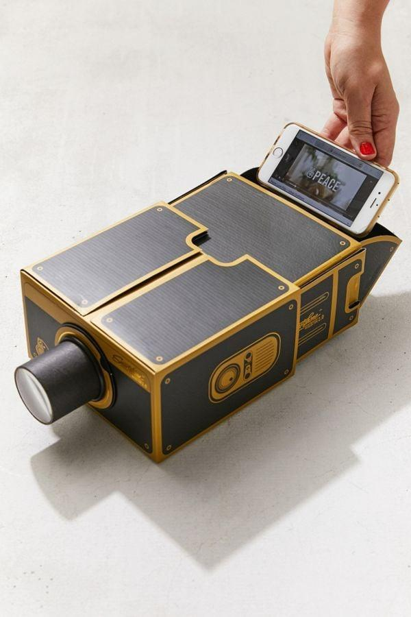 "<p>Take watching movies on your phone to a whole new level with this <a href=""https://www.popsugar.com/buy/Smartphone-Projector-20-373313?p_name=Smartphone%20Projector%202.0&retailer=urbanoutfitters.com&pid=373313&price=30&evar1=savvy%3Auk&evar9=45679349&evar98=https%3A%2F%2Fwww.popsugar.com%2Fsmart-living%2Fphoto-gallery%2F45679349%2Fimage%2F47142386%2FSmartphone-Projector-20&list1=shopping%2Cgifts%2Cgift%20guide%2Cvalentines%20day%2Cgifts%20for%20men%2Cgifts%20under%20%2450&prop13=api&pdata=1"" class=""link rapid-noclick-resp"" rel=""nofollow noopener"" target=""_blank"" data-ylk=""slk:Smartphone Projector 2.0"">Smartphone Projector 2.0</a> ($30).</p>"