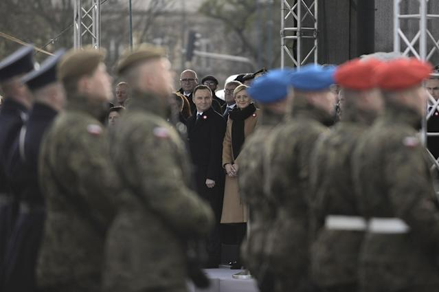 <p>President of Poland, Andrzej Duda (C) and his wife Agata Duda (C-R) attend the official celebrations of the 99th Anniversay of Independence of Poland at the Tomb of Unknown Soldiers, Warsaw, Poland on Nov. 11, 2017. (Photo: Omar Marques/Anadolu Agency/Getty Images) </p>