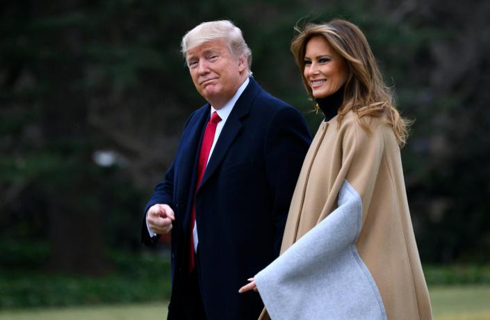 President Trump and first lady Melania Trump walk to Marine One before departing from the South Lawn of the White House last month. (Andrew Caballero-Reynolds/AFP via Getty Images)