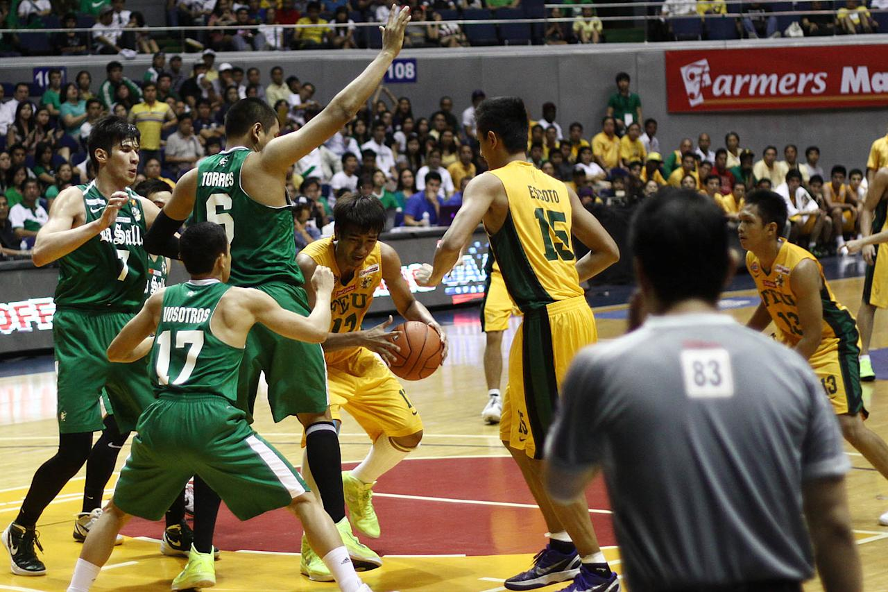 Aldrech Ramos of FEU Tamaraws grabs the rebound against the DLSU Green Archers during the game 56 of the Season 74 of UAAp held at Smart Araneta Coliseum in Quezon CIty, Philippines. (Jerome Ascano/NPPA Images)