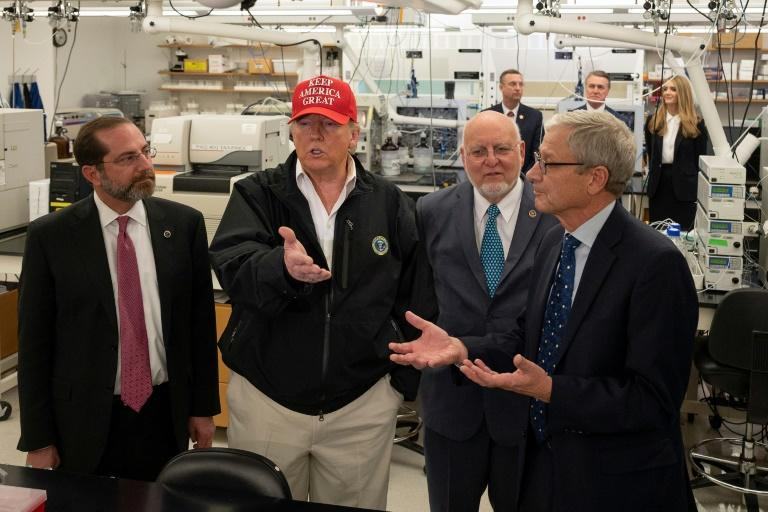 "US President Donald Trump insisted during a visit to the Centers for Disease Control and Prevention the risk of having many people in close proximity ""doesn't bother me at all"""