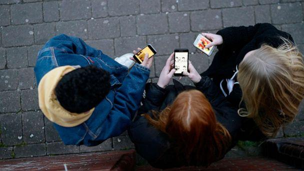 PHOTO: Young people on cell phones. (Stock photo/Justin Lambert/Getty Images)
