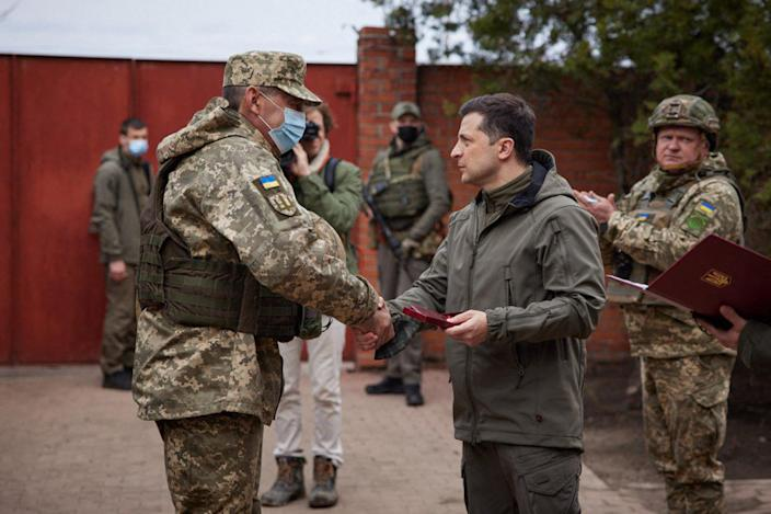 Image: Zelensky shakes hands with a serviceman in the Ukrainian town of Zolote last week (Ukrainian Presidential Press Service / AFP - Getty Images)