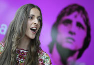"""Myrthe Burger, who plays Johan Cruyff's wife Danny, sings during a presentation of """"14 The Musical"""" in Leusden, Netherlands, Friday, June 11, 2021. On the opening day of the pandemic-delayed European 2020 Soccer Championship, the cast and crew of """"14 The Musical"""", referring to Cruyff's shirt number, raised the curtain on the new musical eulogizing the country's most famous footballing son, Johan Cruyff. (AP Photo/Peter Dejong)"""