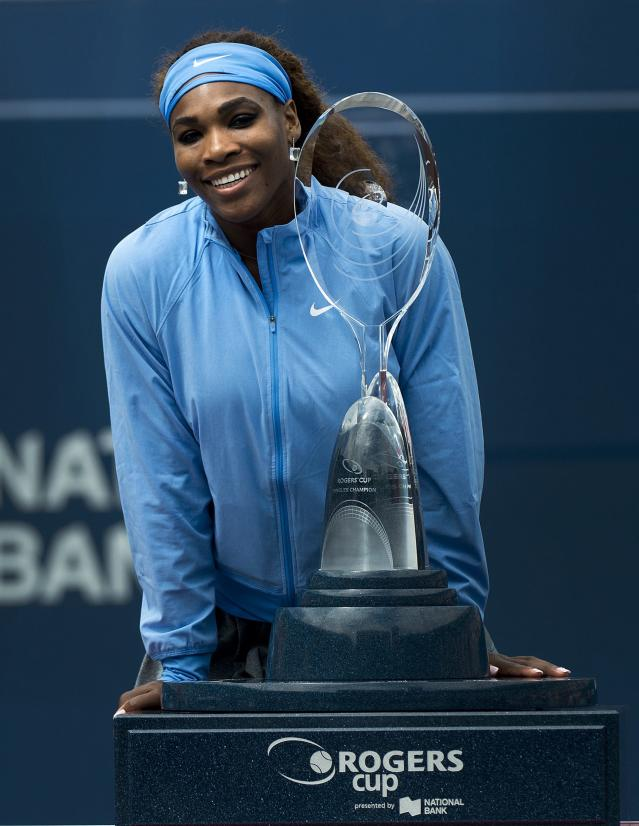 Serena Williams, of the United States, poses for photographs after defeating Sorana Cirstea, of Romania, at the women's singles championship at the Rogers Cup tennis tournament in Toronto, Sunday, Aug. 11, 2013. Williams won 6-2, 6-0. (AP Photo/The Canadian Press, Nathan Denette)