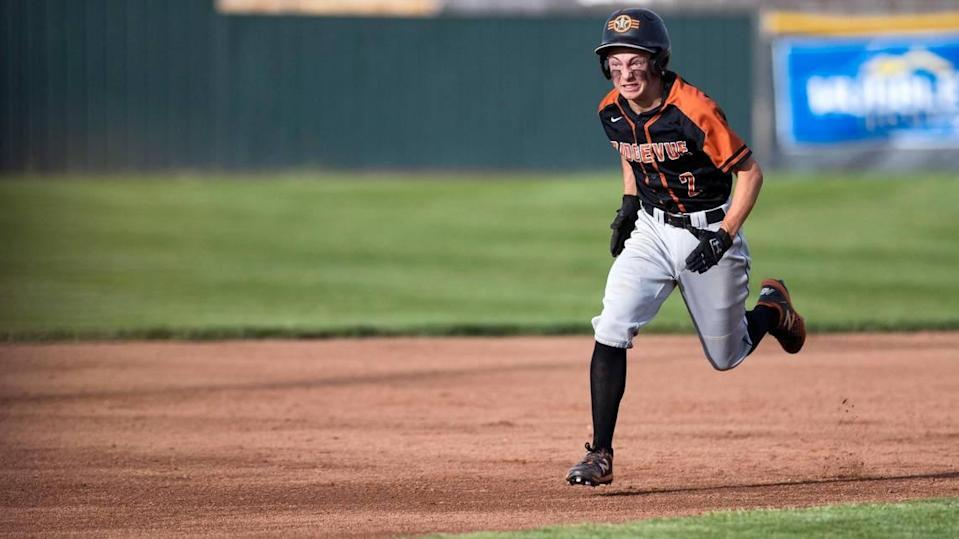 Ridgevue junior catcher Colton Bowman sprints to third base to complete a two-run triple as part of the Warhawks' five-run first inning Thursday.