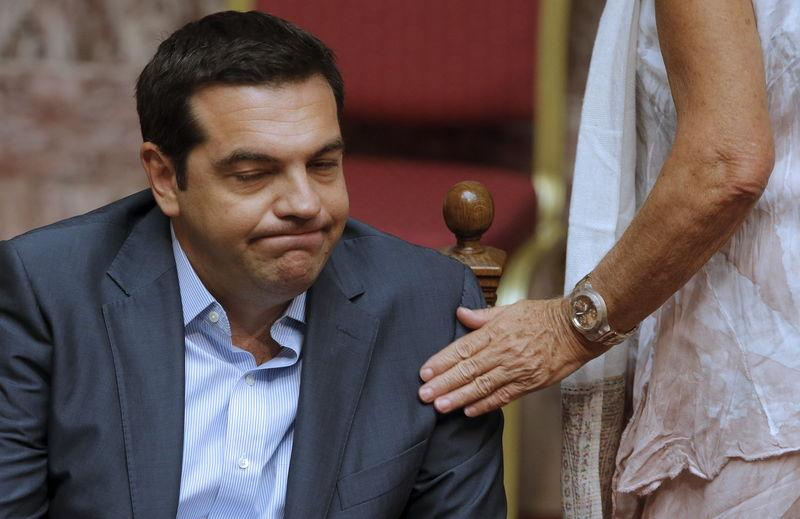 Greek Prime Minister Alexis Tsipras reacts as he attends a parliamentary session in Athens