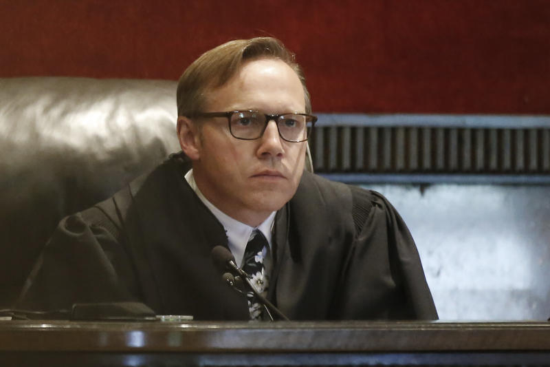 Judge Thad Balkman listens during a hearing to settle disagreements between Johnson & Johnson and the State over his finals judgement in a opioid lawsuit case, Tuesday, Oct. 15, 2019 in Norman, Okla. (AP Photo/Sue Ogrocki)