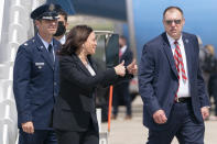Vice President Kamala Harris, center, makes a double thumbs up sign toward members of the media after exiting Air Force Two after a technical issue required the plane to return to Andrews Air Force Base, Md., Sunday, June 6, 2021, after it had already started begun flying to Guatemala City. (AP Photo/Jacquelyn Martin)