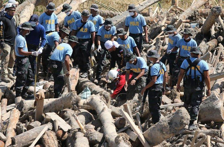 Philippine National Police help in the search for typhoon victims in New Bataan, Compostela Valley. The United Nations launched an $65 million global aid appeal Monday for the victims of the typhoon, the deadliest natural disaster in the Philippines since Tropical Storm Washi killed 1,200 people on Mindanao's north coast last year