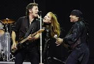 Bruce Springsteen, left, performs with his wife Patty Scialfa, center, and Steven Van Zandt, right, during their 2003 European tour