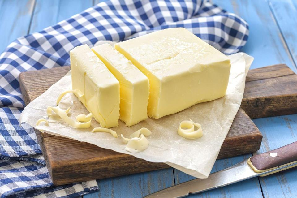 """<p>Butter isn't so bad after all. A <u><a href=""""https://journals.plos.org/plosone/article?id=10.1371/journal.pone.0158118"""" rel=""""nofollow noopener"""" target=""""_blank"""" data-ylk=""""slk:2016 review"""" class=""""link rapid-noclick-resp"""">2016 review</a></u> in <em>PLOS One</em> found very little links between butter consumption and <a href=""""https://www.prevention.com/health/health-conditions/g26253924/weird-heart-disease-risk-factors/"""" rel=""""nofollow noopener"""" target=""""_blank"""" data-ylk=""""slk:heart disease"""" class=""""link rapid-noclick-resp"""">heart disease</a>. Instead, margarine appears to be more of a villain, since it can be full of additives and saturated fats.</p><p>All of these factors can """"increase triglycerides in the blood, which can lead to the build-up of arterial plaque,"""" Rivera says.</p>"""