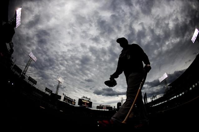 In this image taken with a fisheye lens, St. Louis Cardinals' Alllen Craig heads to the batting cage during a baseball workout Tuesday, Oct. 22, 2013, in Boston. The Cardinals are scheduled to play the Boston Reds Sox in Game 1 of baseball's World Series on Wednesday. (AP Photo/Matt Slocum)