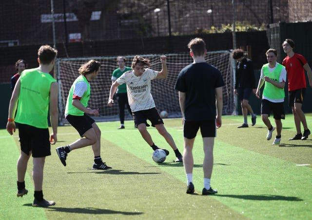 Teams playing seven-a-side football at Powerleague Vauxhall, south London