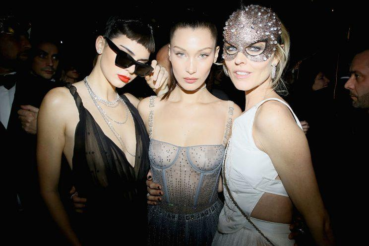 Kendall Jenner, Bella Hadid, and Eva Herzigova at the Christian Dior Bal Masque on Jan. 23, 2017, during Paris Fashion Week. (Photo: Victor Boyko/Getty Images for Dior)