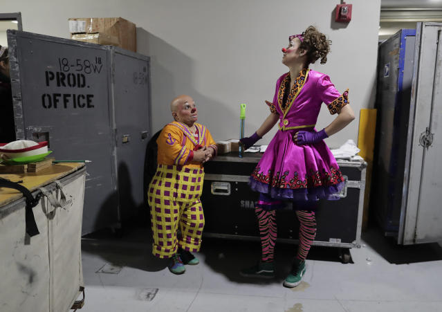 """<p>Clowns Gabor Hrisafis, left, and Beth Walters talk in a hallway of the Dunkin Donuts center before a performance, Thursday, May 4, 2017, in Providence, R.I. """"The Greatest Show on Earth"""" is about to put on its last show on earth. For the performers who travel with the Ringling Bros. and Barnum & Bailey Circus, its demise means the end of a unique way of life for hundreds of performers and crew members. (Photo: Julie Jacobson/AP) </p>"""