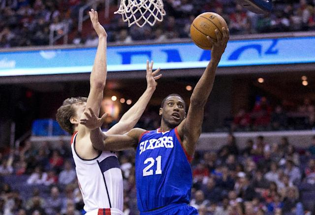 Philadelphia 76ers forward Thaddeus Young (21) scores past Washington Wizards forward Jan Vesely during the first half of an NBA basketball game on Monday, Jan. 20, 2014 in Washington. (AP Photo/ Evan Vucci)