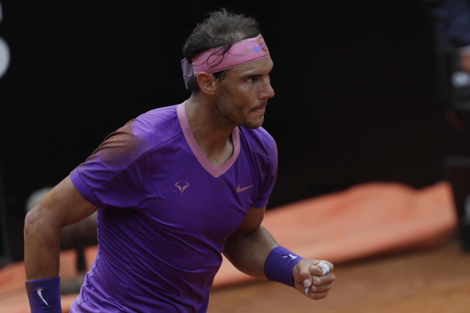 Spain's Rafael Nadal celebrates after winning a point during his quarter-final match against Germany's Alexander Zverev at the Italian Open tennis tournament, in Rome, Friday, May 14, 2021. (AP Photo/Gregorio Borgia)