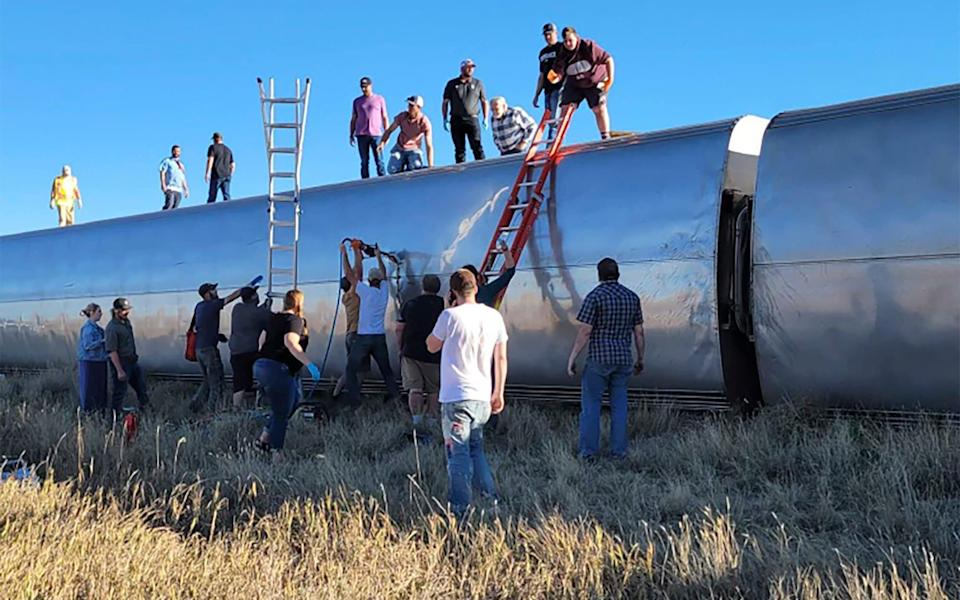 People work at the scene of an Amtrak train derailment in north-central Montana - Kimberly Fossen via AP