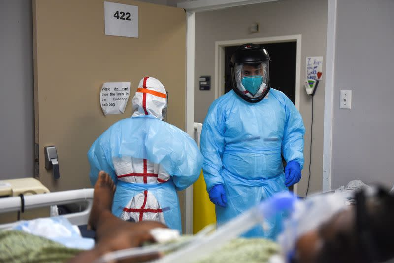 FILE PHOTO: Healthcare workers treat COVID-19 patients in Houston