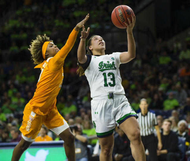 Notre Dame's Marta Sniezek (13) drives past Tennessee's Jazmine Massengill (13) during an NCAA college basketball game Monday, Nov. 11, 2019 at Purcell Pavilion in South Bend, Ind. (Michael Caterina/South Bend Tribune via AP)