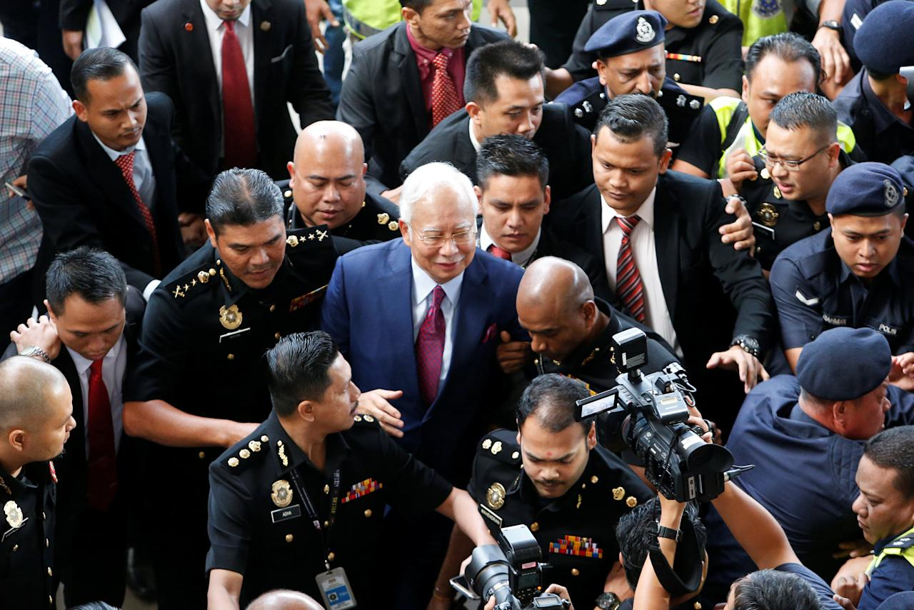 <p>Former Malaysian prime minister Najib Razak being escorted into the Kuala Lumpur Courts Complex on Wednesday (4 July) morning. (PHOTO: Reuters) </p>