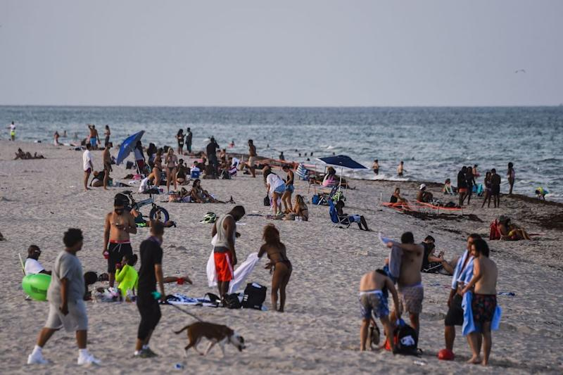 People relax on the beach in Miami Beach, Florida.