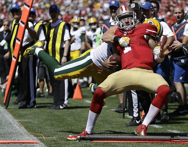 San Francisco 49ers quarterback Colin Kaepernick (7) is tackled as he is out of bounds by Green Bay Packers outside linebacker Clay Matthews during the second quarter of an NFL football game in San Francisco, Sunday, Sept. 8, 2013. (AP Photo/Ben Margot)