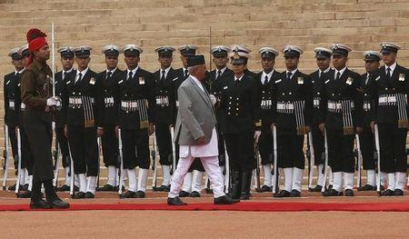 Nepal's Prime Minister Khadga Prasad Sharma Oli inspects a guard of honour during his ceremonial reception at the forecourt of Rashtrapati Bhavan in New Delhi, India, February 20, 2016. REUTERS/Adnan Abidi