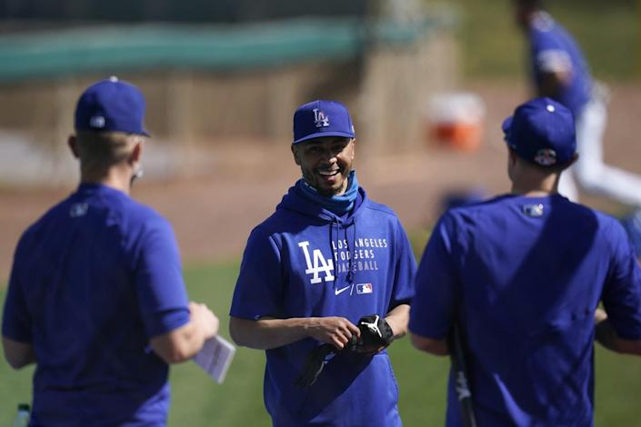 Dodgers hitting coach Brant Brown talks with Mookie Betts and A.J. Pollock.