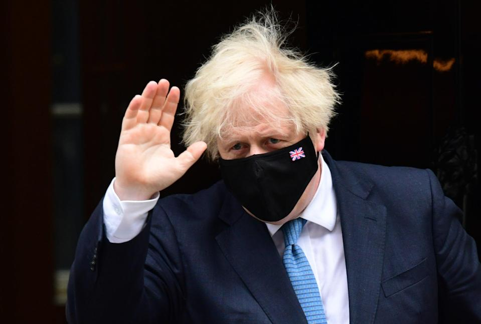 Prime Minister Boris Johnson departs 10 Downing Street, Westminster, London, to attend Prime Minister's Questions at the Houses of Parliament (Ian West/PA) (PA Wire)