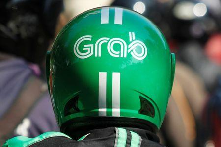The helmet of a Grab bike rider is seen during rush hour traffic in Jakarta