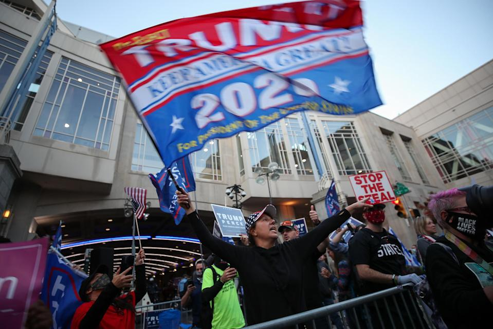 <p>Trump supporters gathered in various cities across the country — as they did in Philadelphia on Friday (right) — in protest of the vote counting that Trump baselessly claimed must be fraudulent if it showed Biden beating him.</p>