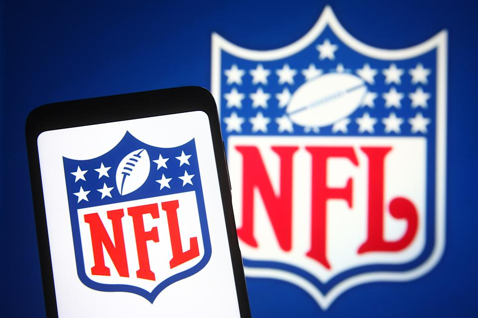 UKRAINE - 2021/06/06: In this photo illustration, an NFL (National Football League) logo is seen on a smartphone and a pc screen in the background. (Photo Illustration by Pavlo Gonchar/SOPA Images/LightRocket via Getty Images)