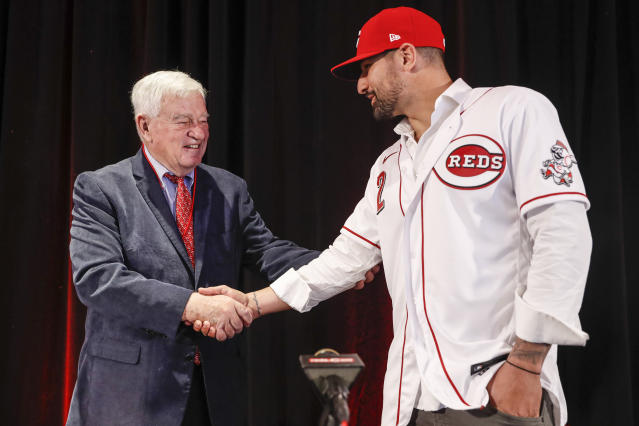 Cincinnati Reds Nick Castellanos, right, shakes hands with Reds chief executive owner Bob Castellini during a news conference announcing his signing with the baseball club, Tuesday, Jan. 28, 2020, in Cincinnati. Castellanos signed a $64 million, four-year deal with the Reds. (AP Photo/John Minchillo)