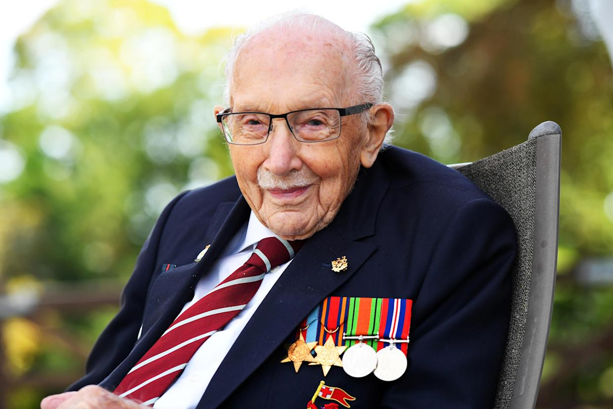 Captain Sir Tom Moore smiles as he launches his autobiography book 'Tomorrow will be a Good Day' at his home in Milton Keynes, Britain September 17, 2020. REUTERS/Dylan Martinez