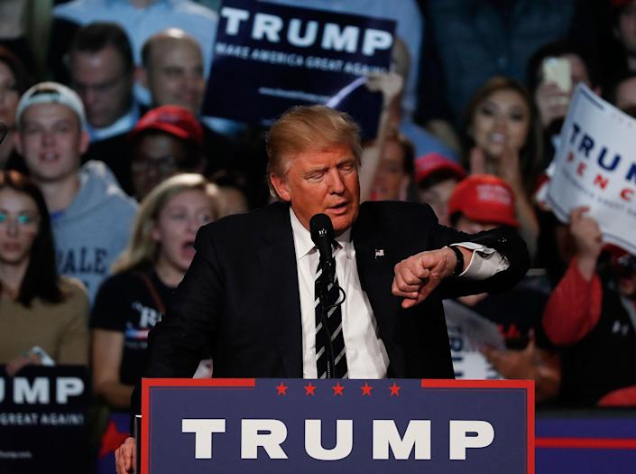 <p>Republican presidential candidate Donald Trump checks his watch while speaking at a campaign rally in Grand Rapids, Mich., Tuesday, Nov. 8, 2016. (Photo: Paul Sancya/AP) </p>