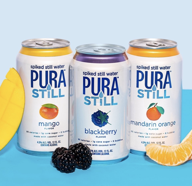 Pura Still spiked water cans