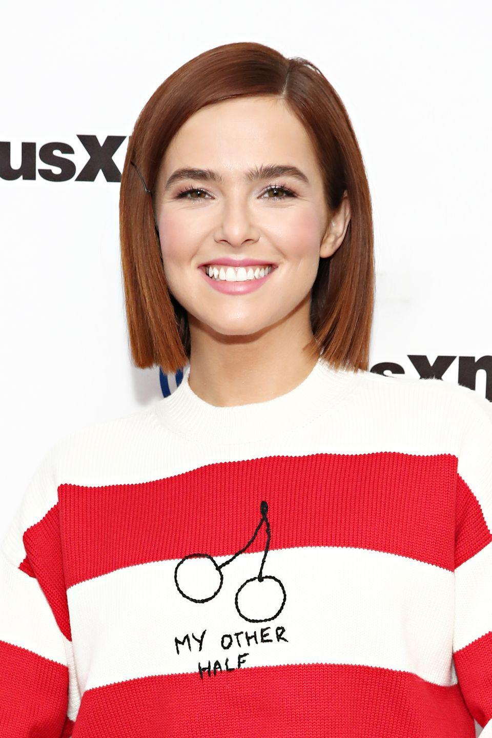 """<p>Falling somewhere between chestnut and true red,<strong> Zoey Deutch</strong>'s coppery auburn shade is a great way for brunettes of any complexion to change up their hair without straying too far from their natural shade. To achieve this look at home, try a few washes of <a href=""""https://overtone.co/products/ginger-coloring-conditioner"""" rel=""""nofollow noopener"""" target=""""_blank"""" data-ylk=""""slk:Overtone's Ginger Coloring Conditioner"""" class=""""link rapid-noclick-resp"""">Overtone's Ginger Coloring Conditioner </a>on hair that is not already color-treated.</p>"""