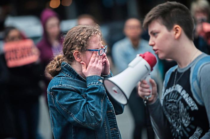 <p>High School student Taylor Fraasch, 16, of Brookline, wipes tears from her eyes as she prepares to speak during a walk-out in solidarity with other high schools across the country to show support for Parkland, Fla., students on Wednesday, Feb. 21, 2018, in downtown Pittsburgh. (Photo: Stephanie Strasburg/Pittsburgh Post-Gazette via AP) </p>