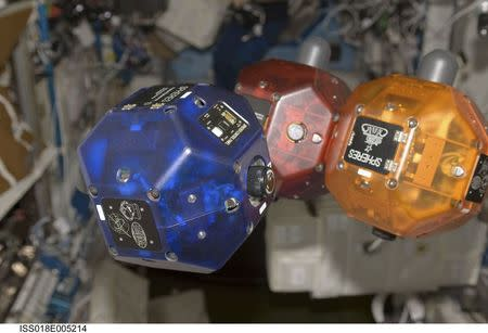 Synchronized Position Hold, Engage, Reorient, Experimental Satellites (SPHERES) Beacon / Beacon Tester are shown floating in zero-gravity in the Destiny laboratory of the International Space Station in this October 26, 2008 NASA handout photo released to Reuters July 3, 2014. REUTERS/NASA/Handout via Reuters