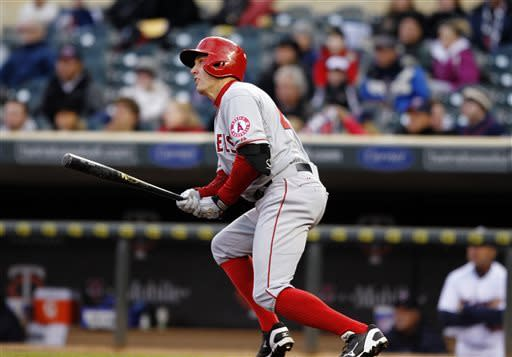 Los Angeles Angels' Peter Bourjos watches after hitting a solo home run against Minnesota Twins starting pitcher Kevin Correia during the first inning of a baseball game Monday, April 15, 2013, in Minneapolis. (AP Photo/Genevieve Ross)