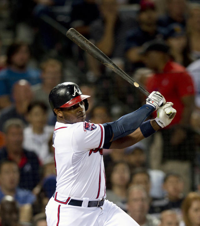 Atlanta Braves left fielder Justin Upton (8) drives in a run with a base ht in the fifth inning of a baseball game against the Los Angeles Dodgers Wednesday, Aug. 13, 2014, in Atlanta. (AP Photo/John Bazemore)