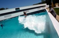 FILE PHOTO: Garazi Sanchez, member of Spain's national surf team, performs in Wave Garden, a giant pool that generates surfable waves, in the Basque town of Aizarnabazabal