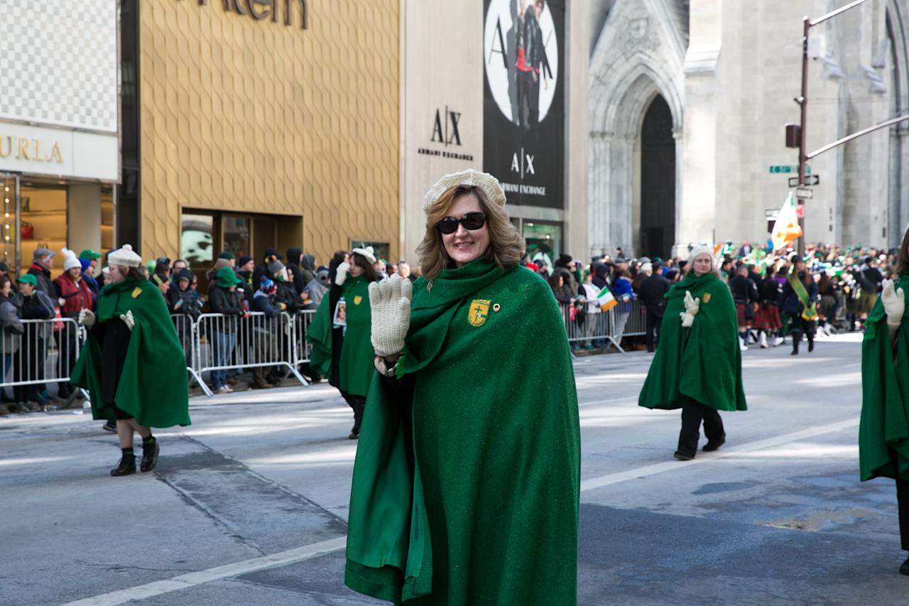 <p>A member from the Donegal Group in an emerald cloak walks in New York City's St. Patrick's Day parade. (Photo: Casey Hollister/Yahoo Style) </p>